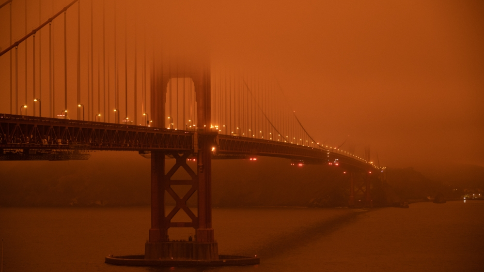 In Pictures: Dull orange sky as wildfires rage across western US