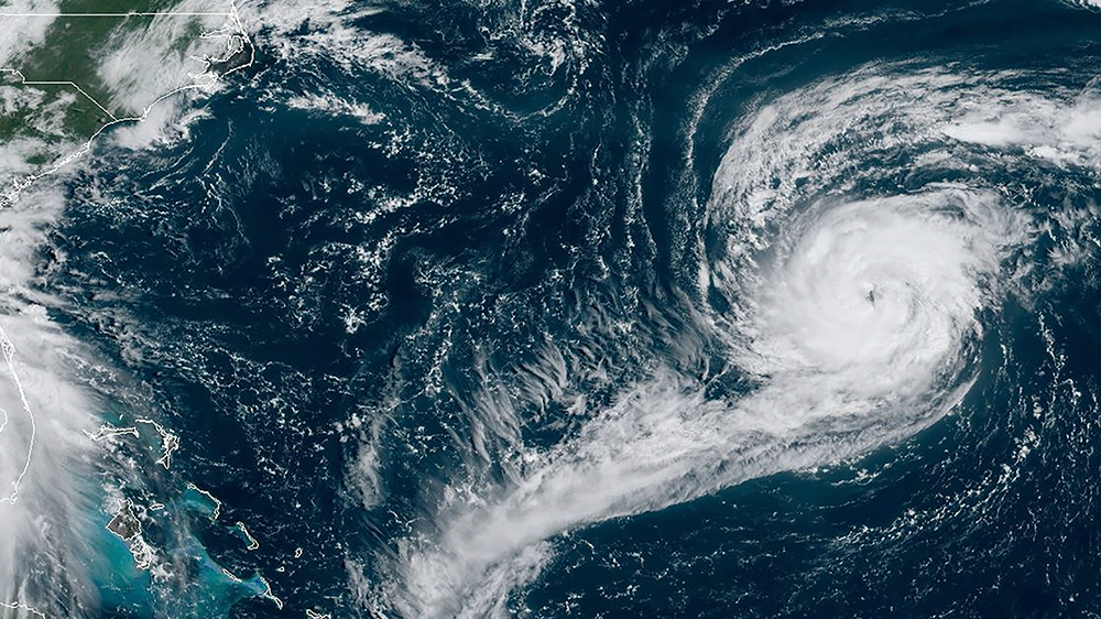 Hurricane Paulette rolls toward Bermuda as Sally approaches US