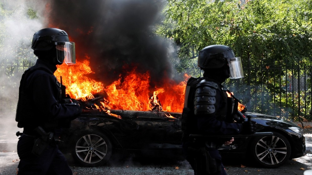 Clashes and arrests as 'yellow vest' protests return in France