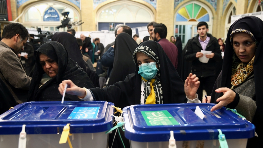 Iranians head to polls in delayed runoff parliamentary vote