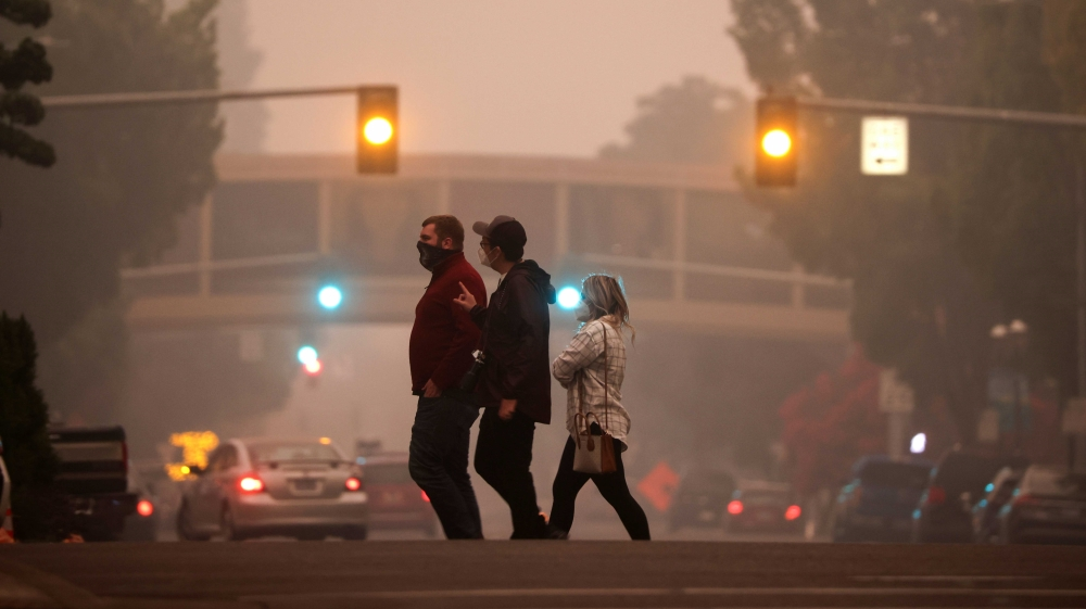 Half million Oregonians told to flee as Western wildfires kill 24