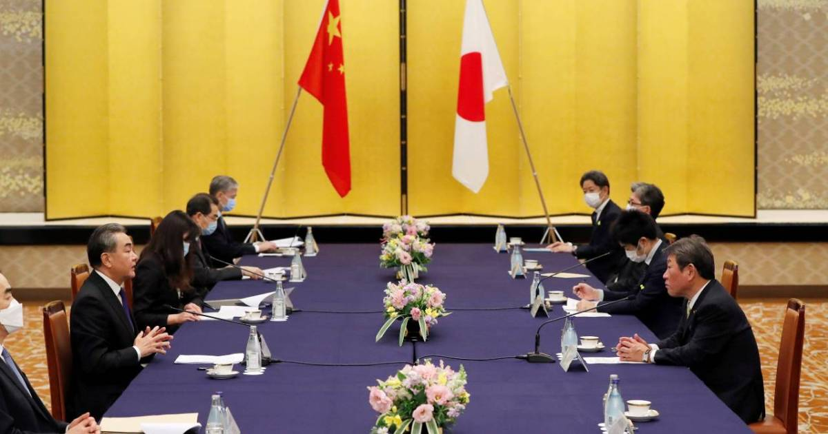 China's Wang meeting Suga in first high-level talks with Japan PM